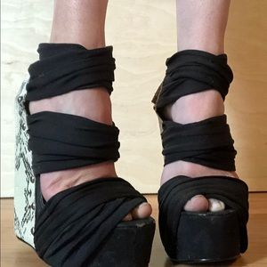 Black and faux snakeskin high wedges